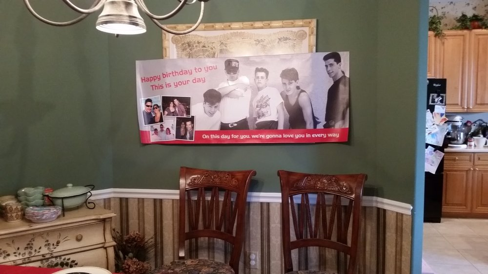 My sister made this birthday banner for me using an old school NKOTB photo along with selfies and meet and greet photo from our first cruise.