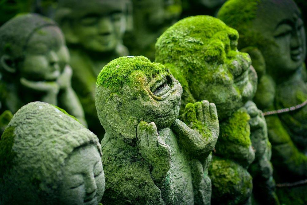 Jizo Statues.  Jizo is a bodhisattva  who helps to shepherd children to the spirit world.