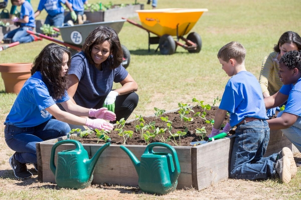 Former First Lady Michelle Obama participates in a garden planting with students at Burke County Middle School in Waynesboro, Ga., April 7, 2016. (   Official White House Photo by Amanda Lucidon   )