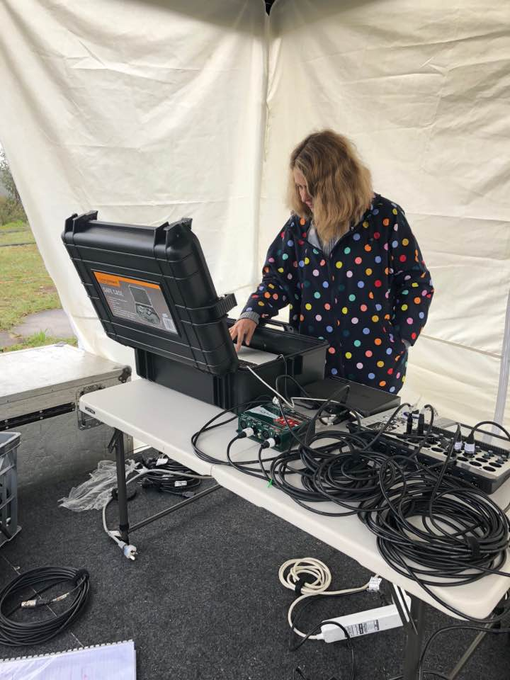 Amanda Cole setting up the sound for A Galaxy of Suns at Linden Observatory
