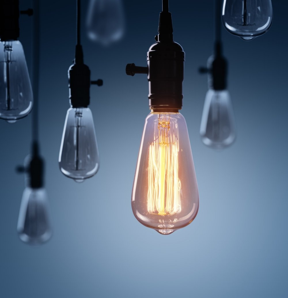 Innovation-And-Leadership-Concept---Glowing-Bulb-lamp-689955934_2449x1228.jpeg
