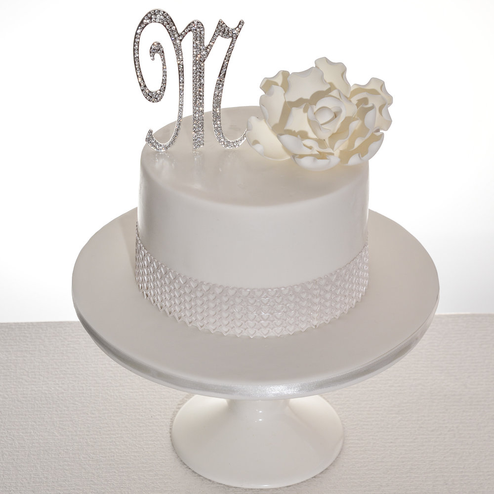 White-Lace-and-Flower-Bling-Topper-Wedding-Cake.jpg