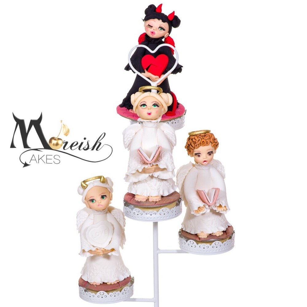 angels on cake stand.JPG