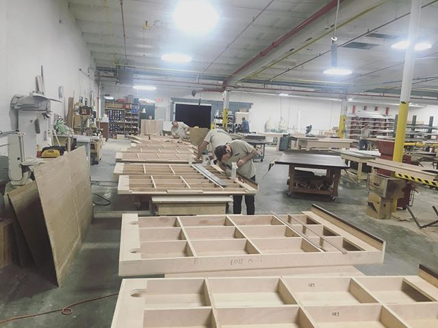 Bunch of the guys filing away on some custom modular desk pieces in the shop today #custom #furniture #interiordesign #officeinterior #architecture #studiocraft #woodworking