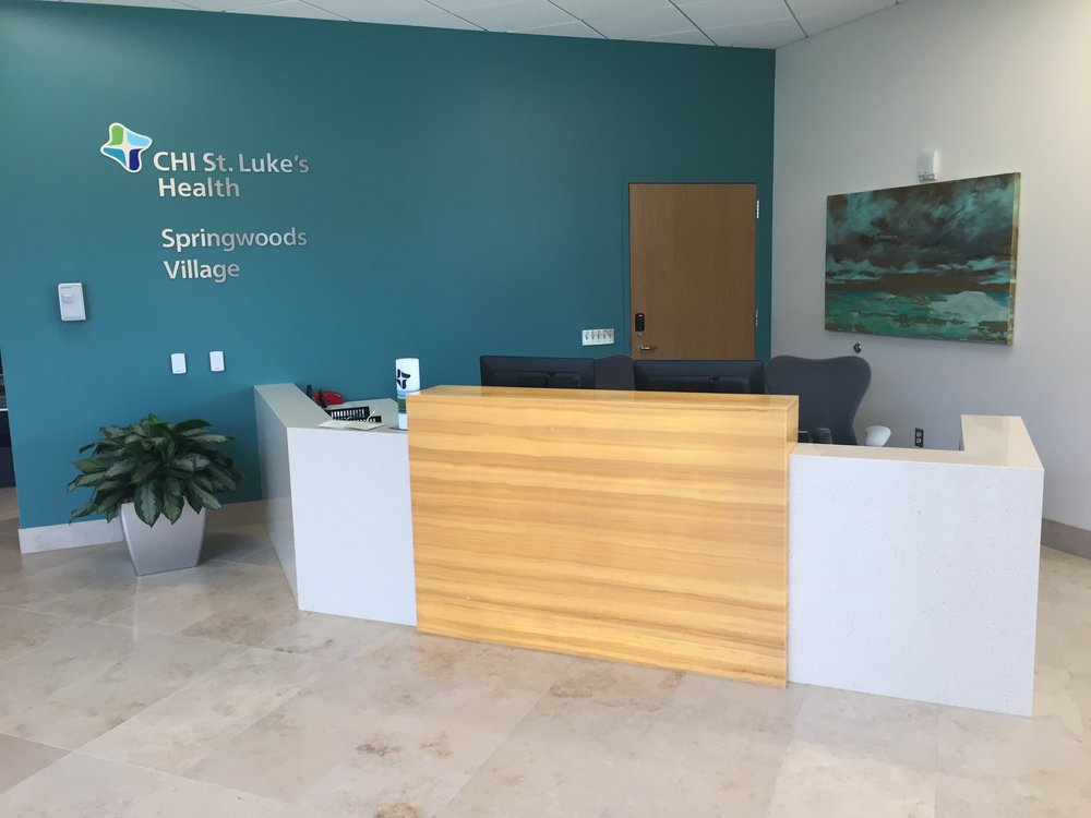 St Lukes Reception Area - Warm transaction accent complements clean, modern lines for welcoming aesthetic. Read More