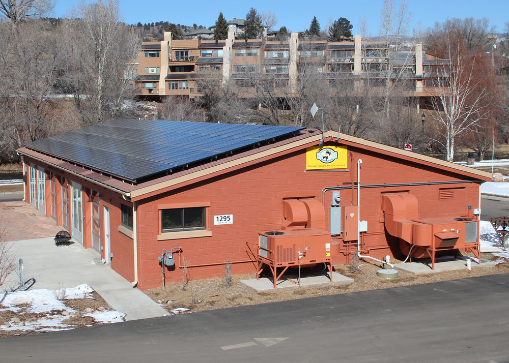 The Shaw Solar Banner flies proudly after we installed a 20 kW system on the roof of the Powerhouse Science Center.