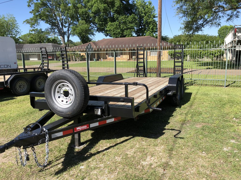 7'x20' Heavy Duty Car/Equipment Trailer$100/Day - This trailer features the traditional equipment trailer style with swing-up loading ramps. The floor sits lower in this trailer and there is a lip down the sides of the bed. They also offer a full tilt model with angle iron frame. This trailer is great for loading a single piece of equipment - especially when using in a more confined loading and unloading area such as a construction site, etc.