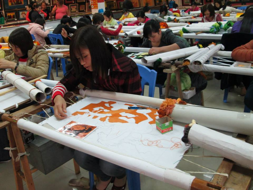 Embroiderers at the craft factory