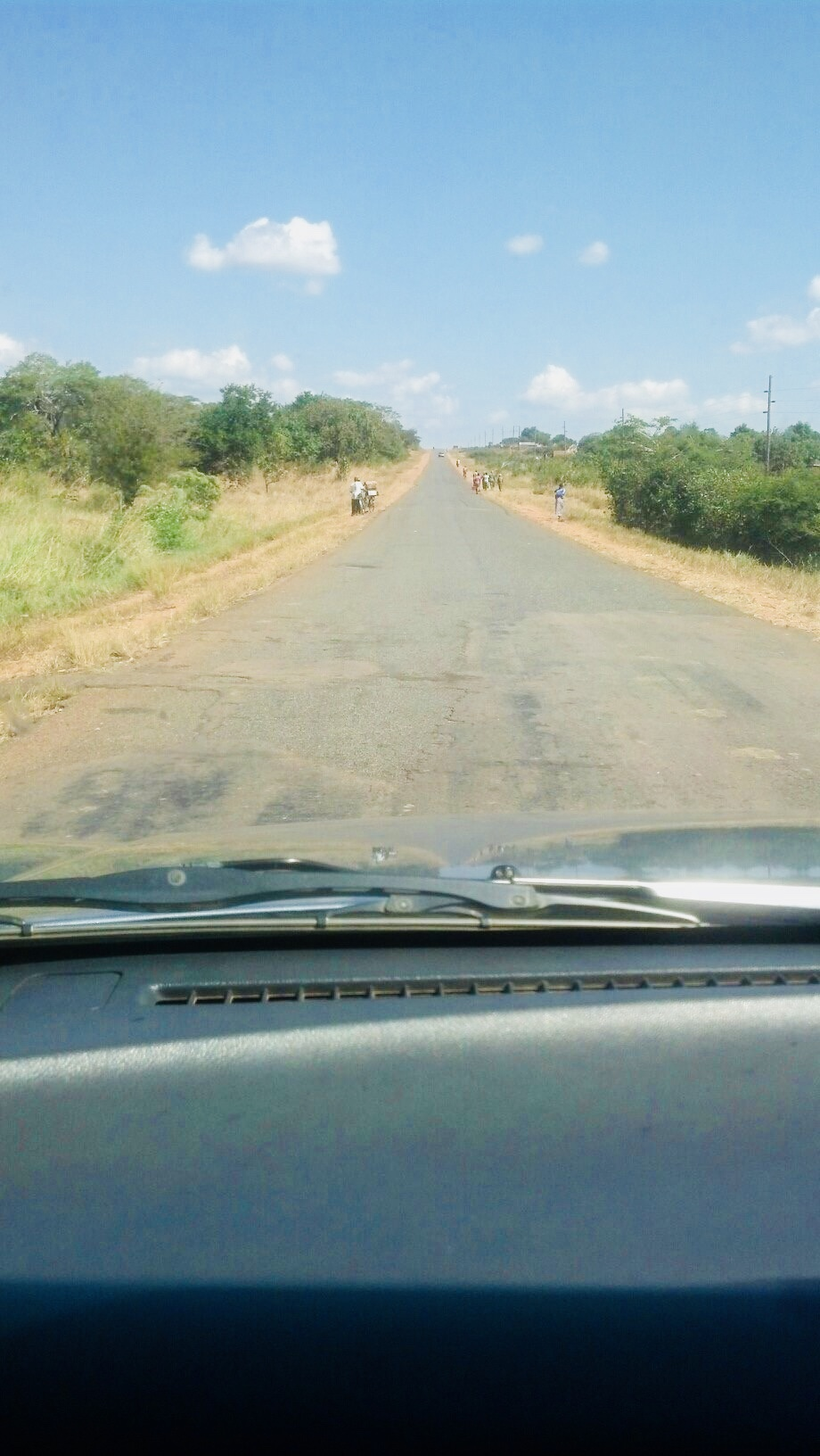 Roads throughout Zambia are like this - no car traffic, but lots of pedestrian traffic.
