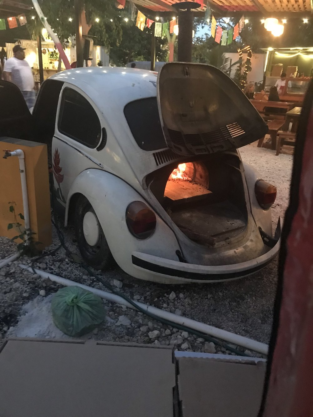 One of the food trucks turned a VW bug into a pizza oven.