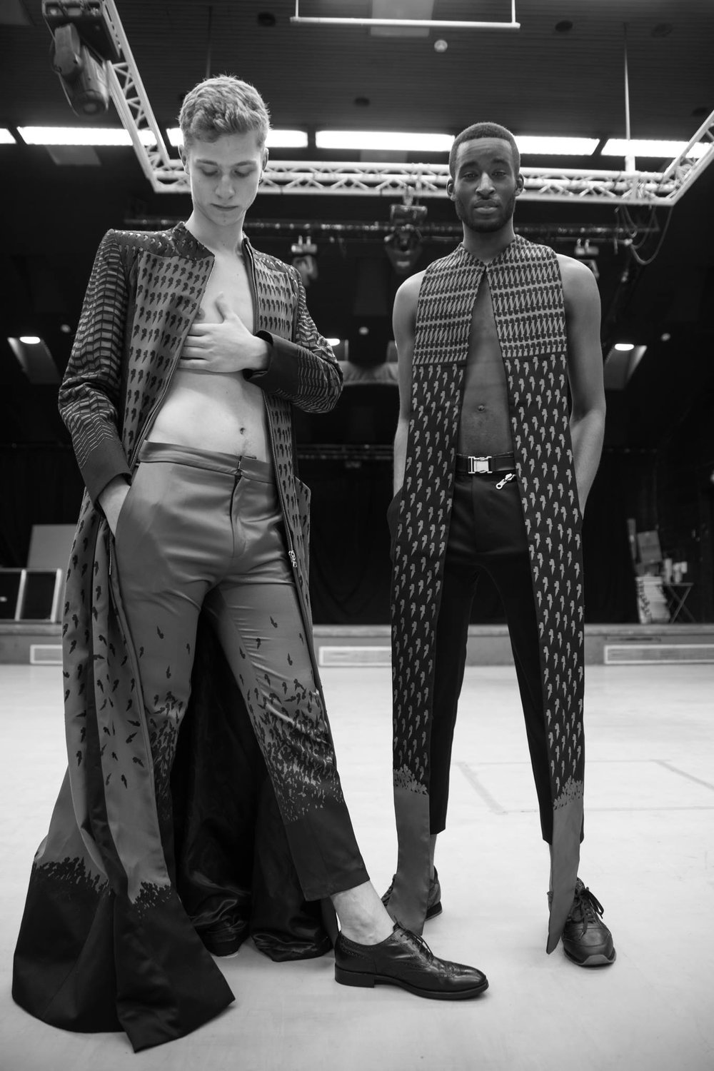 CRUZADO   Ryan graduated in 2015 from Northumbria University with a cutting-edge, urban collection inspired by ruggedly exposed brutalist architecture. His respect for the unpretending honesty of such stark constructions communicate strength and functionality; encapsulating a modern approach to masculinity. The rigid shapes of the architecture create contrasting and angular areas of shadow and light, which too have informed the structure and shape of his work. He is particularly inspired by the serenity of Tadao Ando's architecture, and uses the muse of 'The New Crusader' as a human embodiment of the ethos behind his designs.