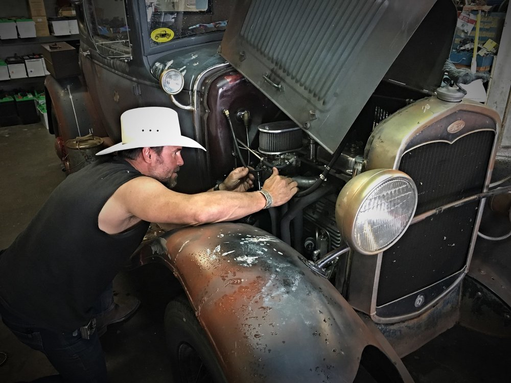 tim mcclellan wrenching on 1934 plymouth.jpg