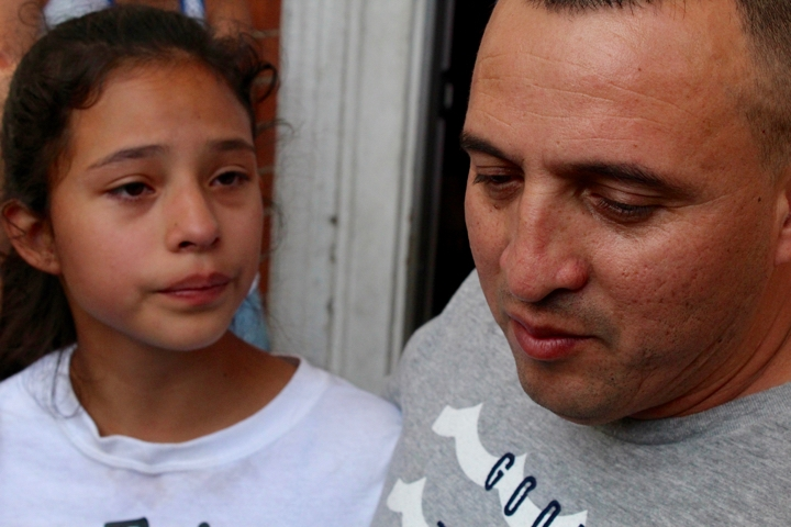 Marco Antonio Reyes Alvarez with his daughter earlier this week at the church. Christopher Peak photo.