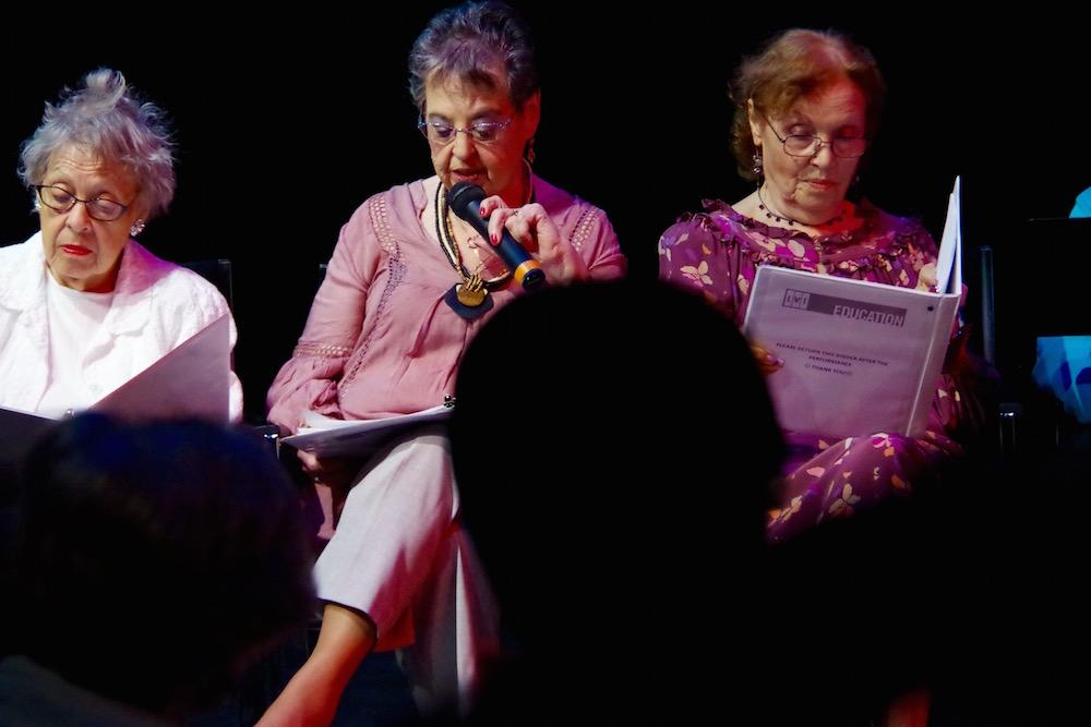 Terry Berger, Elaine Feldman (on mic) and a reader for Ruth Maxim.