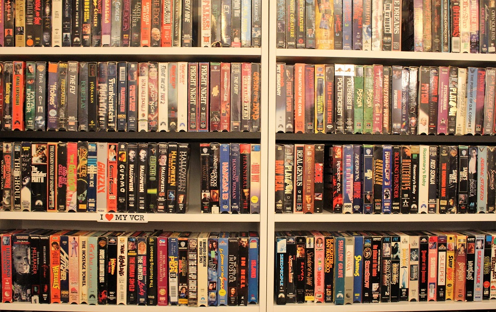 The VHS shelf in the back room of The Archive.