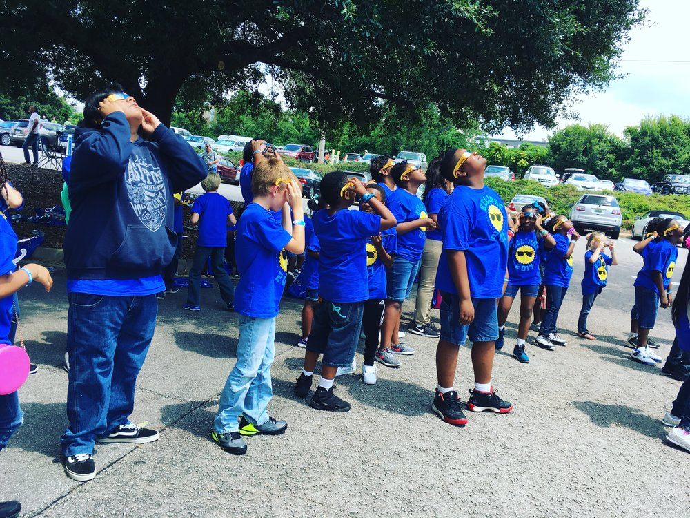 A school group looks on as the eclipse begins in Columbia, South Carolina. Lucy Gellman Photo.