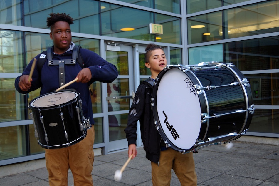 Kuaun Silva and Marrion Jackson, both eighth graders at John C. Daniels, welcome students back with some percusson.