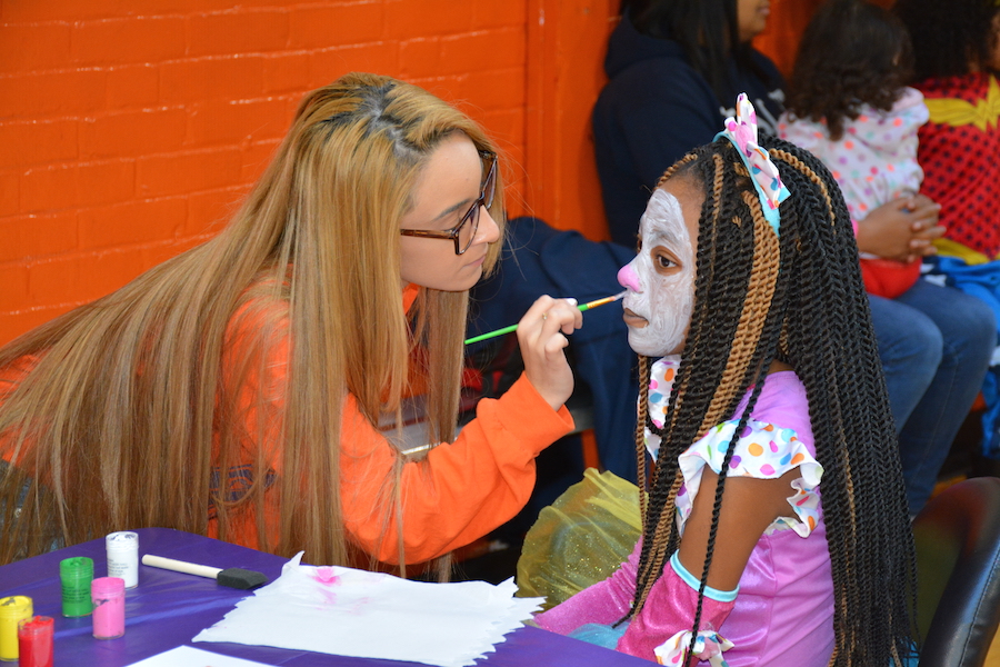 LEAP counselor face painting. Henry Fernandez Photos.