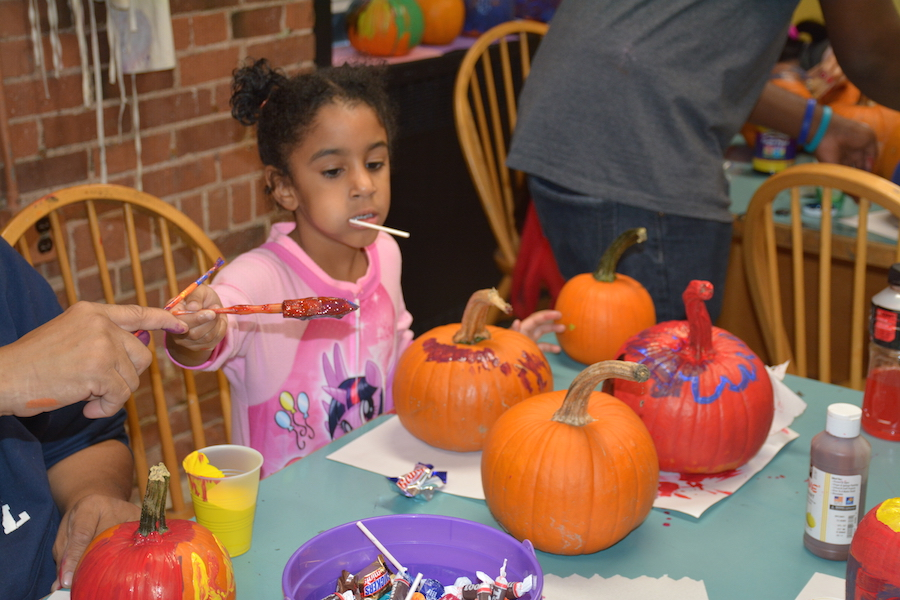 A LEAPer paints pumpkins donated by Melillo's Greenhouse and General Store in North Branford.