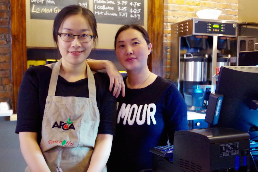"Baristas Xiaoxiao ""Connie"" Kang and Rose Zeng. The Wangs, who own the cafe, asked not to be photographed. Lucy Gellman Photos."