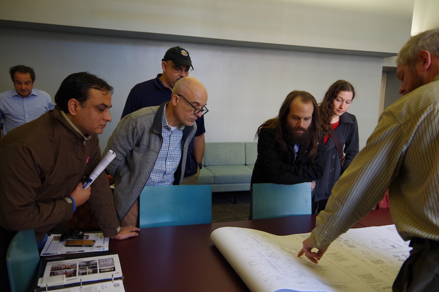 From left to right: Viswanath Parajuli, Andrea Corazzini , Bruce Ramirez, Dan Blomberg and Amber Bennett. Pointing to the rendering is architect Brian Cleveland, a representative of  Buchanan Architecture.