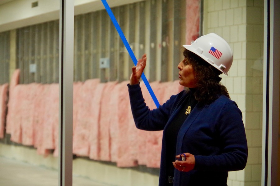 Judy Alperin, CEO of the Jewish Federation of Greater New Haven, led a tour of the permises earlier this week. The room to which she's gesturing will soon be a fitness center and TRX climbing wall. Lucy Gellman Photo.