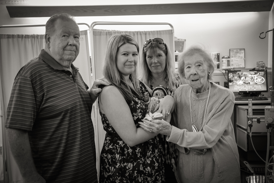 Ashley Brandl with her family and Zane in the NICU. JoAnn Marrero photo.