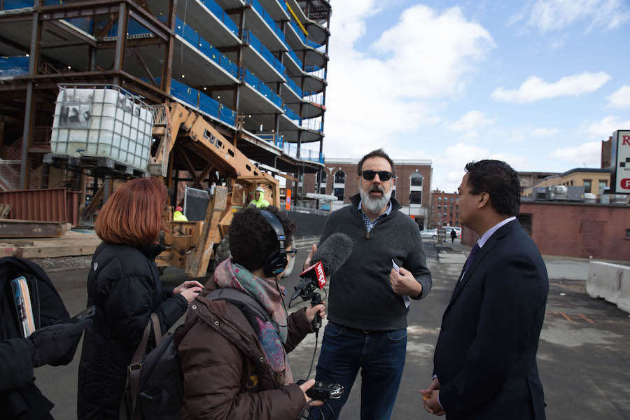 John Dankosky interviews Mike Mathis of MGM at the construction site of a resort casino in downtown Springfield, Mass. NEXT Producer Andrea Muraskin records the conversation. Photo by Ryan Caron King for NENC.