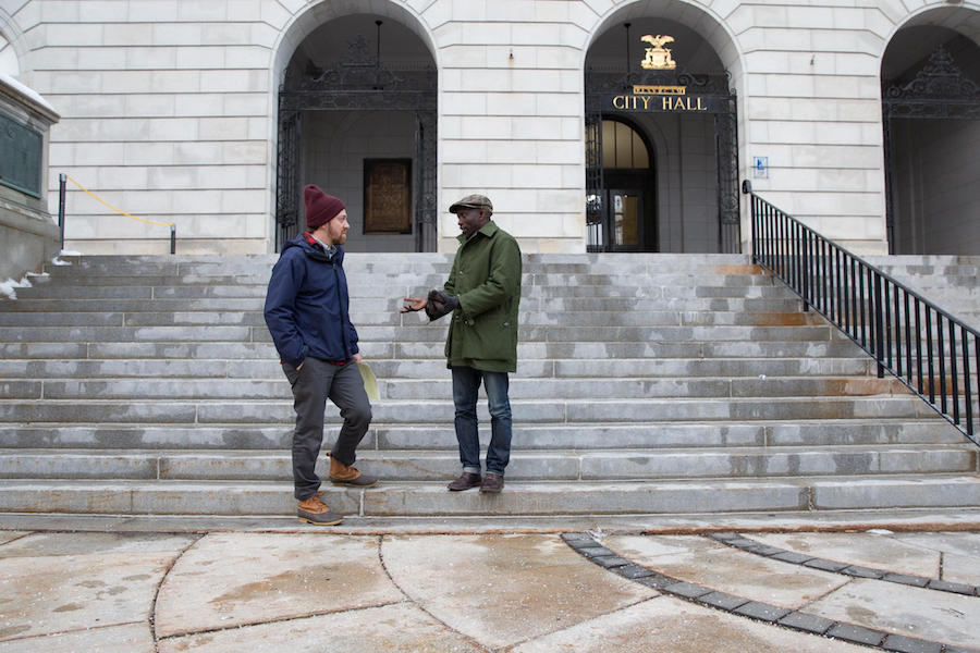 Pious Ali chats with a constituent on the steps of city hall in Portland, Maine. Elected in 2016, Ali is the first African-born Muslim to serve on Portland's city council. Photo by Ryan Caron King for NENC.