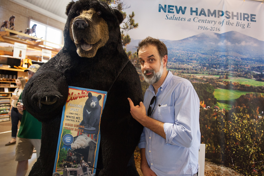 John Dankosky poses with a new friend in the New Hampshire Building at the Big E. Photo by Ryan Caron King for NENC
