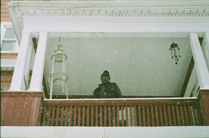 """I remember one day—this is not actually a great photo but it's one of my favorites—it's this guy on his second-floor porch. I was walking down Elm Street during a snow day, and he called my name, and was like: 'Hey! will you take a photo of me?'"" Monica Bunton Photo."