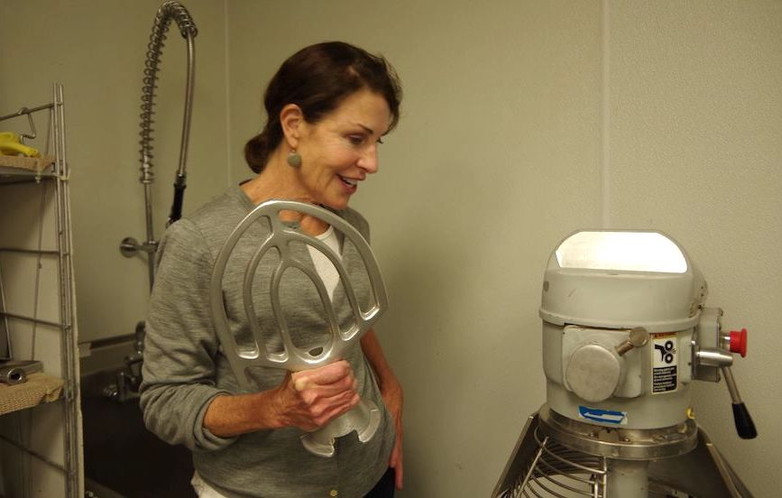 "As a home baker, Hurwitz was used to a small mixer, or doing the recipe by hand. Now, she is using a 20-quart mixer for most batches. The next size up, she said in the interview, is ""large enough to take a bath in."""