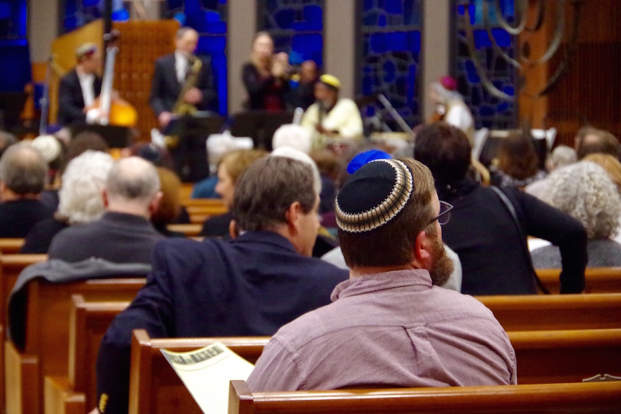 As the 7:30 p.m. service drew near, the pews filled with attendees from Jewish, Muslim, Bahai, Buddhist, and Christian Backgrounds. Lucy Gellman Photo.