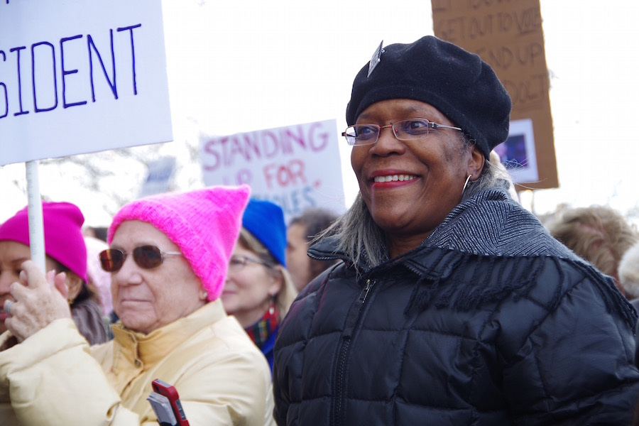 """Tracy Carter:""""I'm here because women rock, I'm here for women's rights."""" Lucy Gellman Photos."""