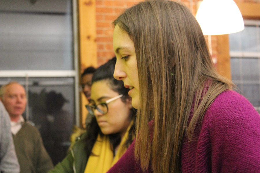 Food justice advocate and FES student Cara Donovan (in the pink) and others line up for dinner. Lucy Gellman Photo.
