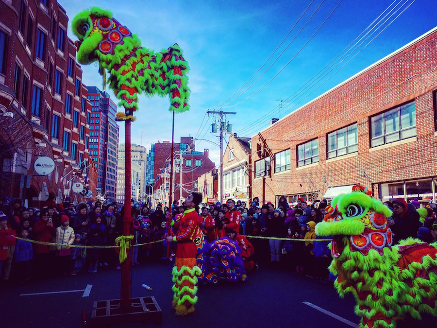 "Dancers from the  Wan Chi Ming Hung Gar Institute Dragon and Lion Dance Team  stunned during the parade. Toward the end, one scaled a pole to ""eat"" a head of lettuice. Lucy Gellman Photos."