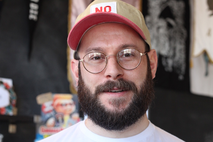 """Alex Dakoulas in the shop Tuesday afternoon. """"I wanted to do some pop culture and film merchandise. And I wanted to do it right,"""" he said."""