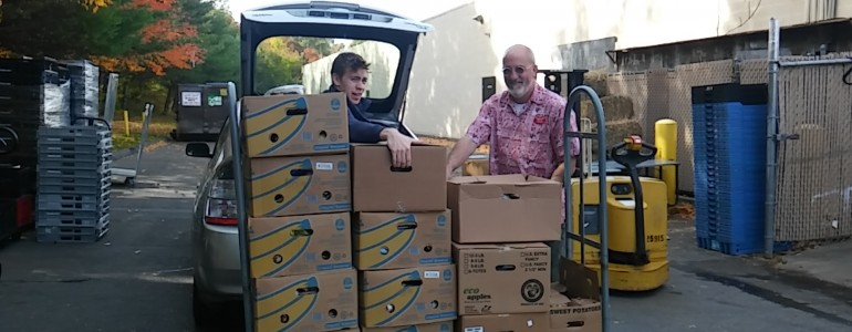 Martin's son on a food rescue mission. Food Rescue U.S. Photo.
