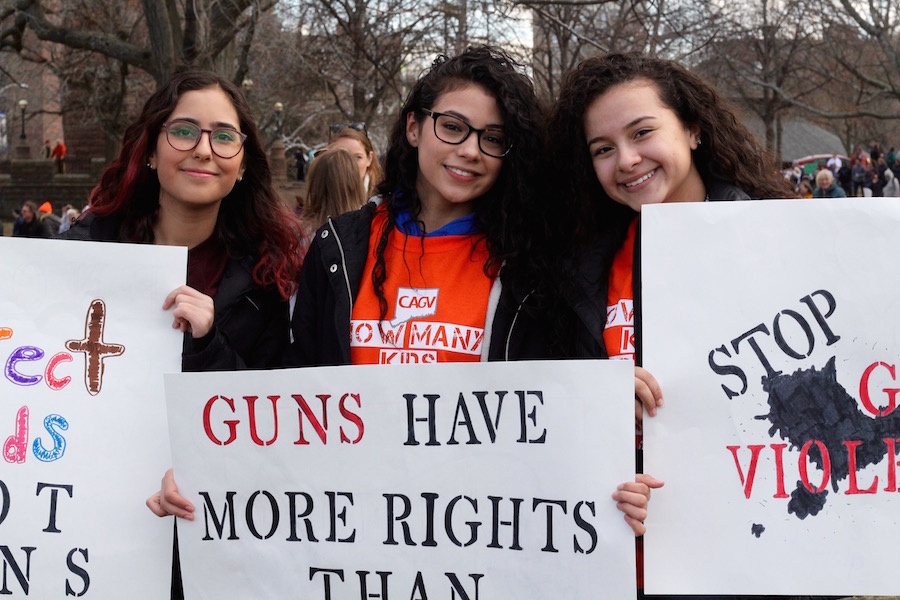 "From Meriden, 15-year-olds Elizabeth Pasion, Tatyana Maldonado, and Jailine Carrero stopped for a moment to pose around Maldonado, whose sign read ""Guns Have More Rights Than My Vagina."""