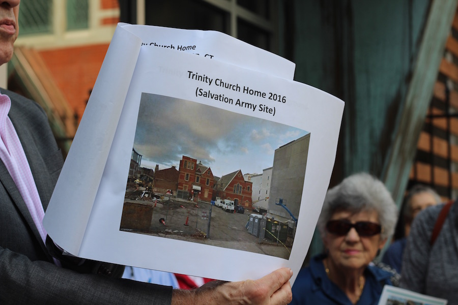 Gardner shows members images of the old Salvation Army buildings. While the chapel remained for historic preservation, the home was torn down by Metro Star Properties.