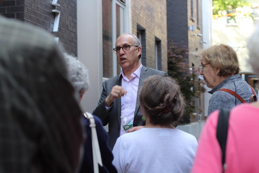 Gardner speaks to members in the mid-block mews.