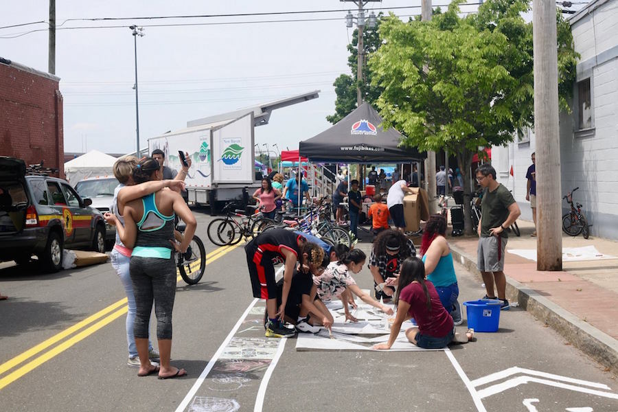 The pop-up bike lane takes shape. New Haven Bike Month Photo.