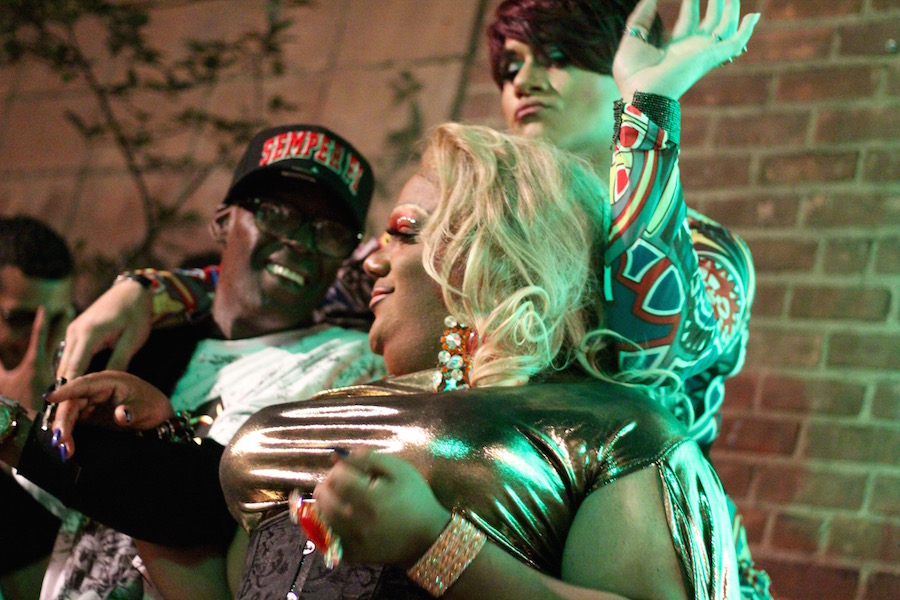 Anita D. Visa and reigning Empress Electra B. Flowers Devereaux with an attendee who sat on the stage for the entire night.