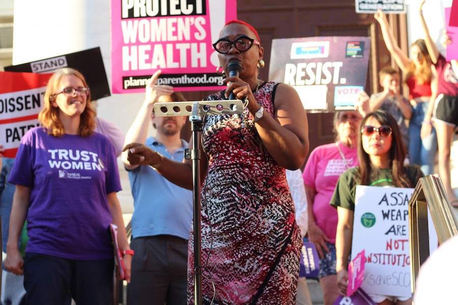 State Rep. Robyn Porter was one in a packed lineup of speakers to speak at a #SaveSCOTUS rally Tuesday evening. She challenged those at the rally not just to call their legislators, but to reach out to family members and friends in other states and urge them to call their legislators as well.  Lucy Gellman Photos.