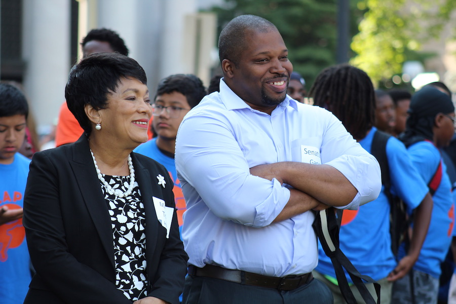 "Mayor Toni Harp and State Sen. Gary Winfield. To a rapt audience, Winfield recalled growing up in ""10J,"" a low-income household in the South Bronx where books from the New York Public Library became a key to escaping poverty. He told the students that a lot of people from his neighborhood don't make it out—but he did, in part, because of reading. ""We didn't have access to a lot,"" he said. ""But what we had was books. Those books changed my life completely."""