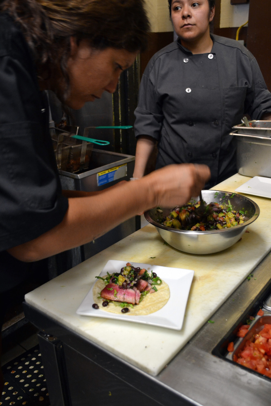Salazar prepares tacos for Te Amo Tequila's new menu alongside Chef Elisa Cordero of Barracuda.