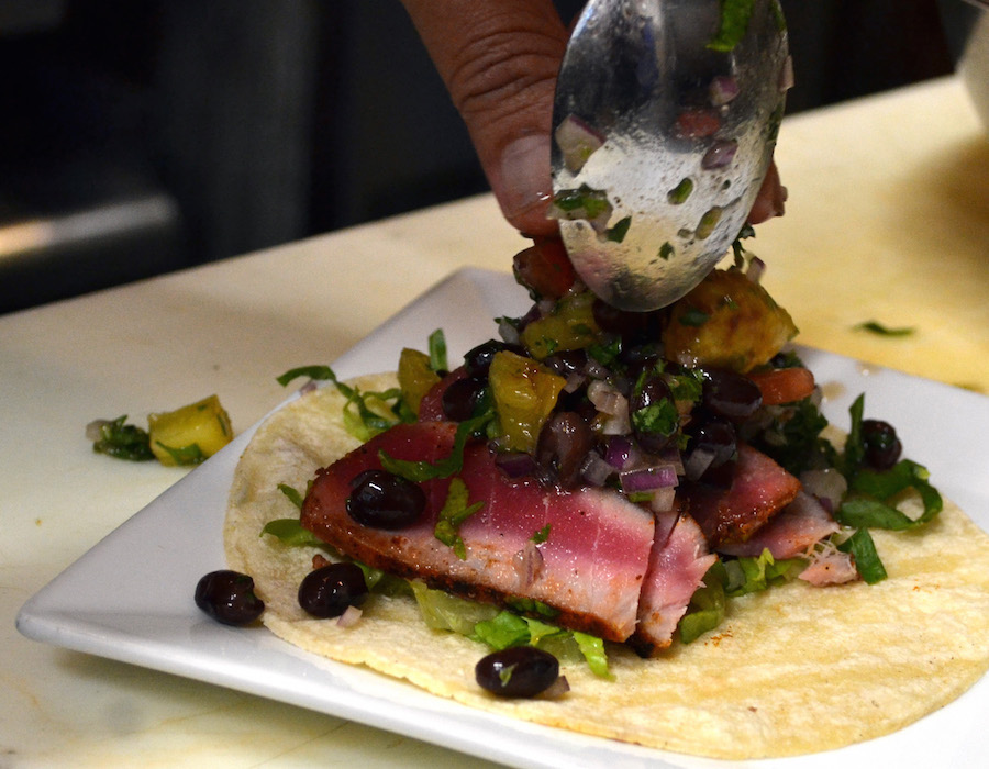 Salazar plates a blackened tuna taco with a grilled pineapple black bean pico de gallo.