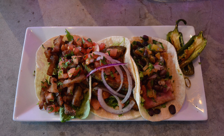 Left to right: plantain and pork belly, fried avocado, blackened tuna with grilled pineapple black bean pico de gallo.