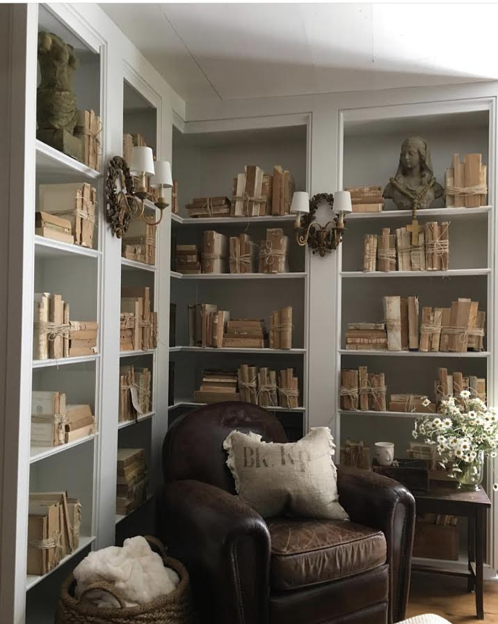 """img src=""""bookshelf and leather chair quiet spot at old suthern soul farm"""""""
