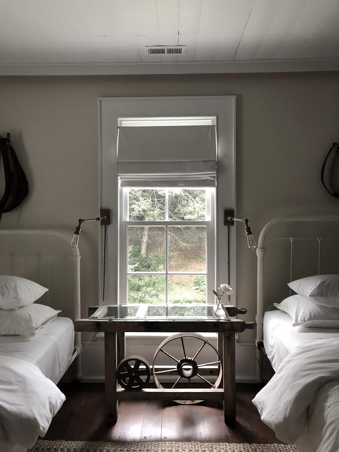 """img src=""""guest bedroom with beds window and lighting at old suthern soul farm"""""""
